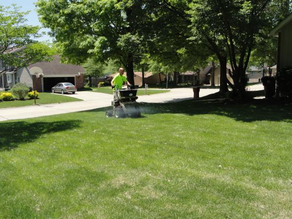 Applying fertilizer to a lawn