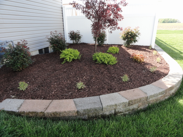 Mulching of landscape areas