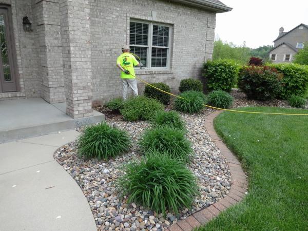 Perimeter pest control treatment around a home