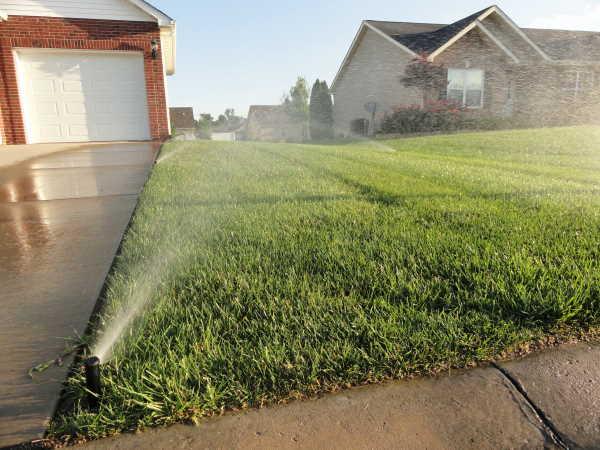 Sprinkler System watering a lawn