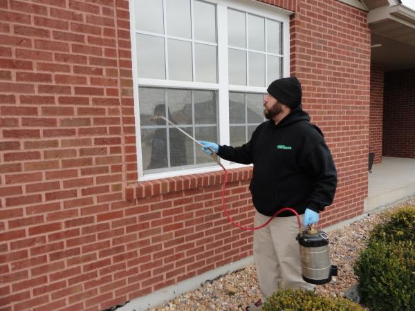 Perimeter Pest Control Spraying around a home