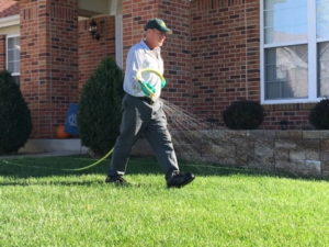 Perimeter Pest Control Spraying the Lawn